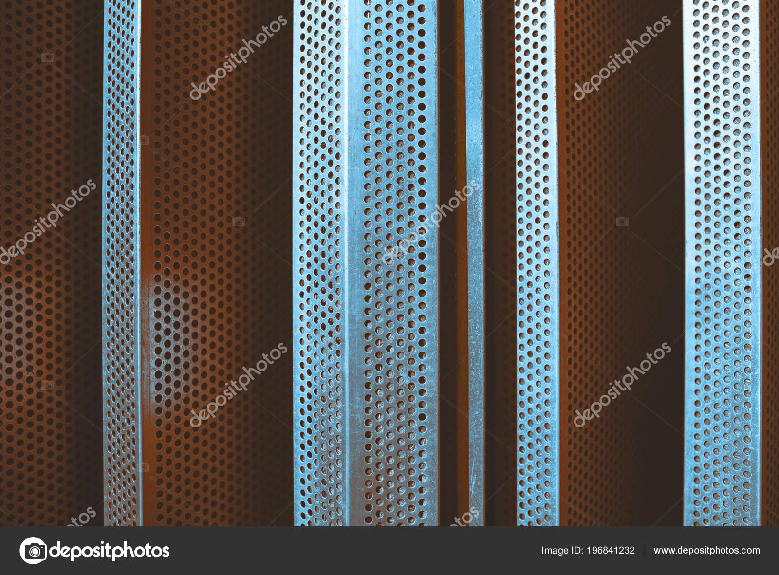 perforated metallic wall bars frame finishing work stock photo