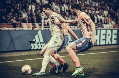 LYON, FRANCE - 16 May, 2018: Florian Thauvin (L) against Diego Godin during Lucas Hernandez the final UEFA Europa League match between Atletico Madrid vs Olympic Marseille at the Groupama Stadium, France