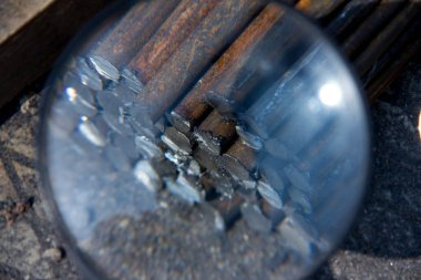 Industrial background through a magnifying glass. Rebar texture. Rusty rebar for concrete pouring. Steel reinforcement bars. Construction rebar steel work reinforcement. Closeup of Steel rebars.