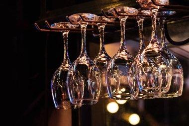 Glasses hanging over bar rack, Glasses suspended above a bar