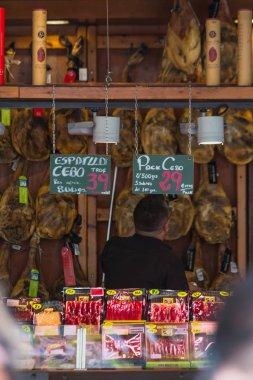 Jamon of different types, hung in an open shop in the center of Tarragona, Spain, Costa Dorada. Walk around Tarragona 13.06.2019.