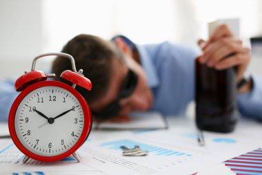 Businessman in blue shirt asleep at work