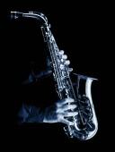 Photo saxophonist playing alt saxophone, blue image