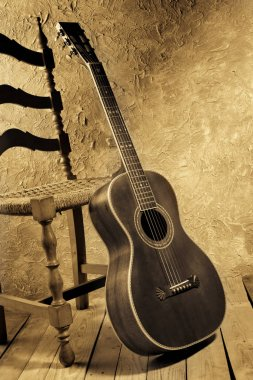 vintage acoustic blues guitar with chair vintage style image