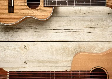 ukuleles on wooden table top view,music living background