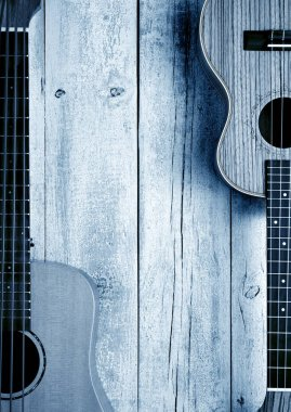 ukuleles on wooden table top view,music blue living background
