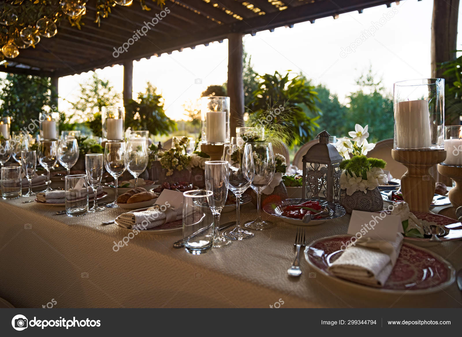 Outdoor Wedding Celebration At A Restaurant Festive Table Setting Catering Wedding In Rustic Style In Summer Beautiful Small Bouquets On A Table Stock Photo C Izik Md 299344794