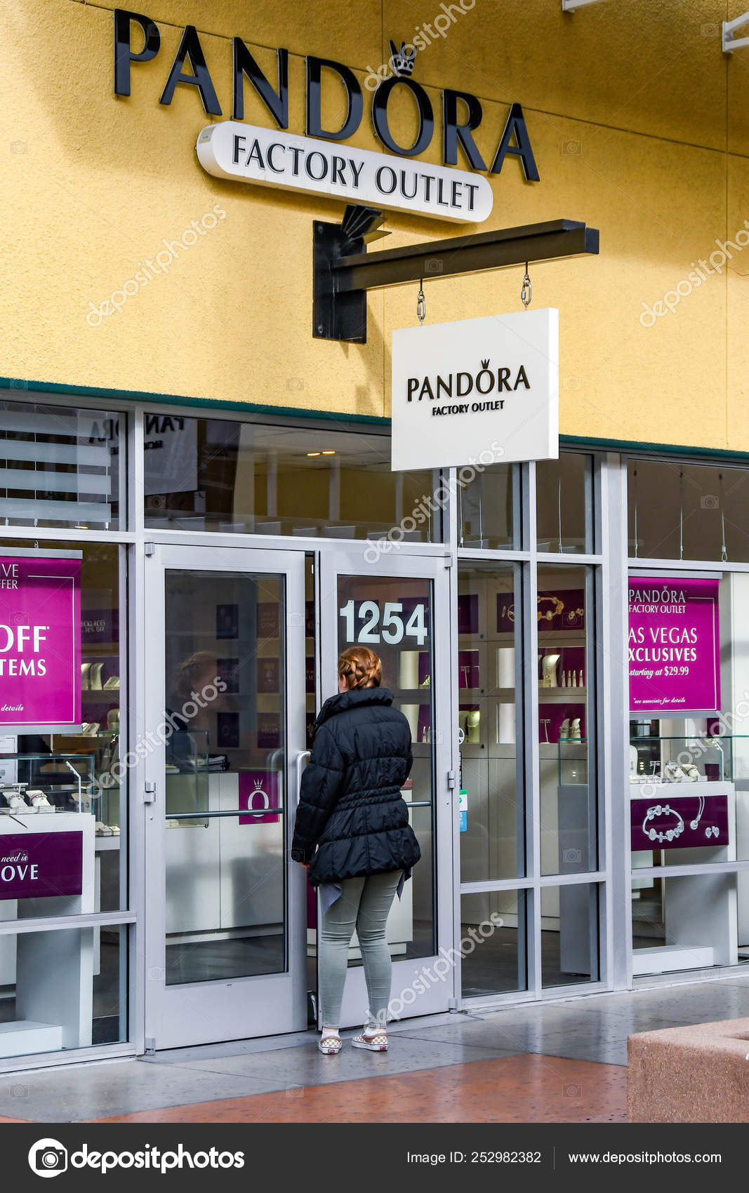 LAS VEGAS, NV, USA - FEBRUARY 2019: Person entering the Pandora store in  the Premium Outlets north in Las Vegas. 252982382