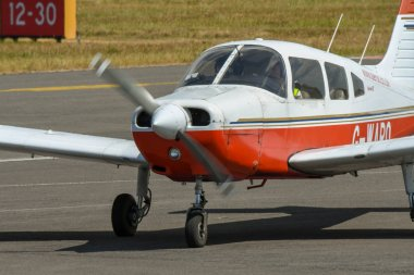 CARDIFF WALES AIRPORT, WALES - JULY 2018: Light aircraft taxiing after landing at Cardiff Wales Airport