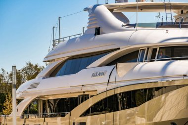 CANNES, FRANCE - APRIL 2019: Close up view of the side of the superyacht Kolaha berthed in the Port Pierre Canto harbour in Cannes. It is owned by Sheikh Khaled bin Ahmed Al-Juffali.