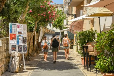 ANACAPRI, ISLE OF CAPRI, ITALY - AUGUST 2019: People in one of the narrow streets of the hilltop town of Anacapri on the Isle of Capri.