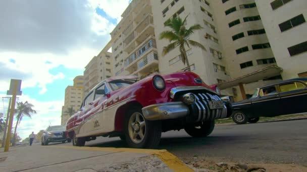 Havana / Cuba - 03 22 2019: Time lapse. Old red car on Havana street