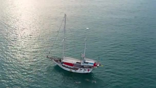 beautiful white sailboat off the coast of Koh Samui. Shot by drone