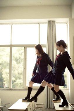 Asian schoolgirls in classroom