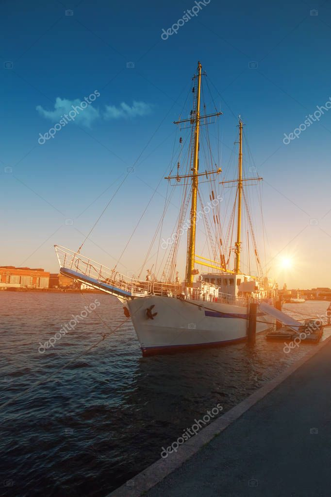Beautiful evening sunset, sailing ship on the pier, Neva river, St. Petersburg, Russia. Vasilievsky island.