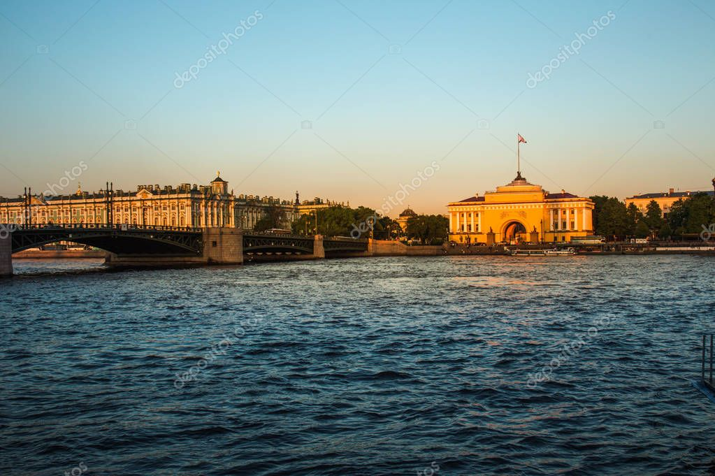 The historical center of St. Petersburg. Russia. View of the Admiralty building. Visible Palace bridge, the Hermitage. Sunset.