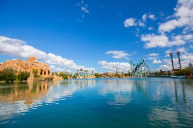 Roller coaster Hulk and lake in Universal Islands of Adventure theme park at Universal Orlando Resort in Orlando, Florida, USA