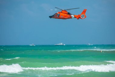 USA. FLORIDA. MIAMI BEACH. MAY 2019: US COAST GUARD AIR SEA RESCUE DEMONSTRATION. MH-65D Dolphin helicopter