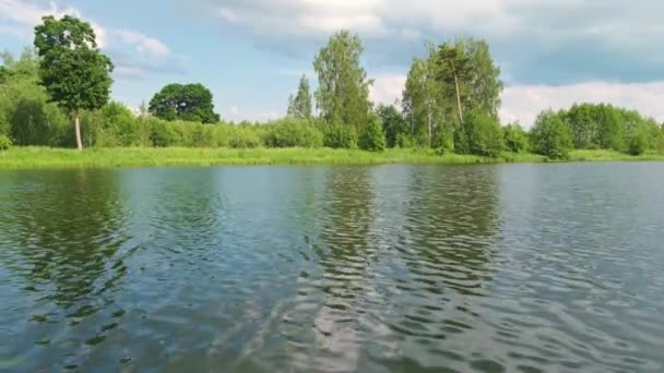 waves on the surface of the lake water. freshness of the summer landscape
