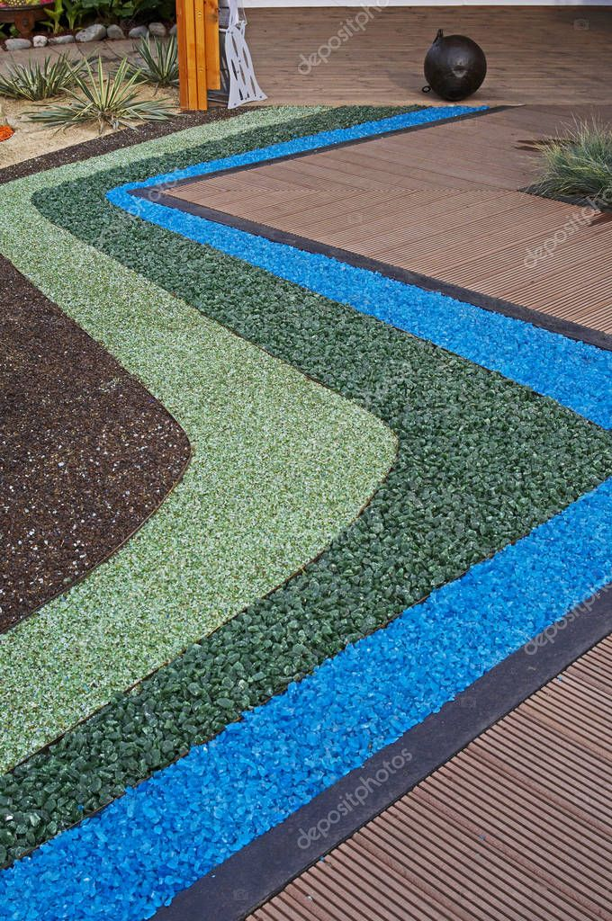 Decorative use of coloured chippings to form a garden border