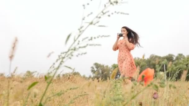 A girl takes pictures of a beautiful nature. Long dark hair. Pretty and slender model. Slow motion. HD
