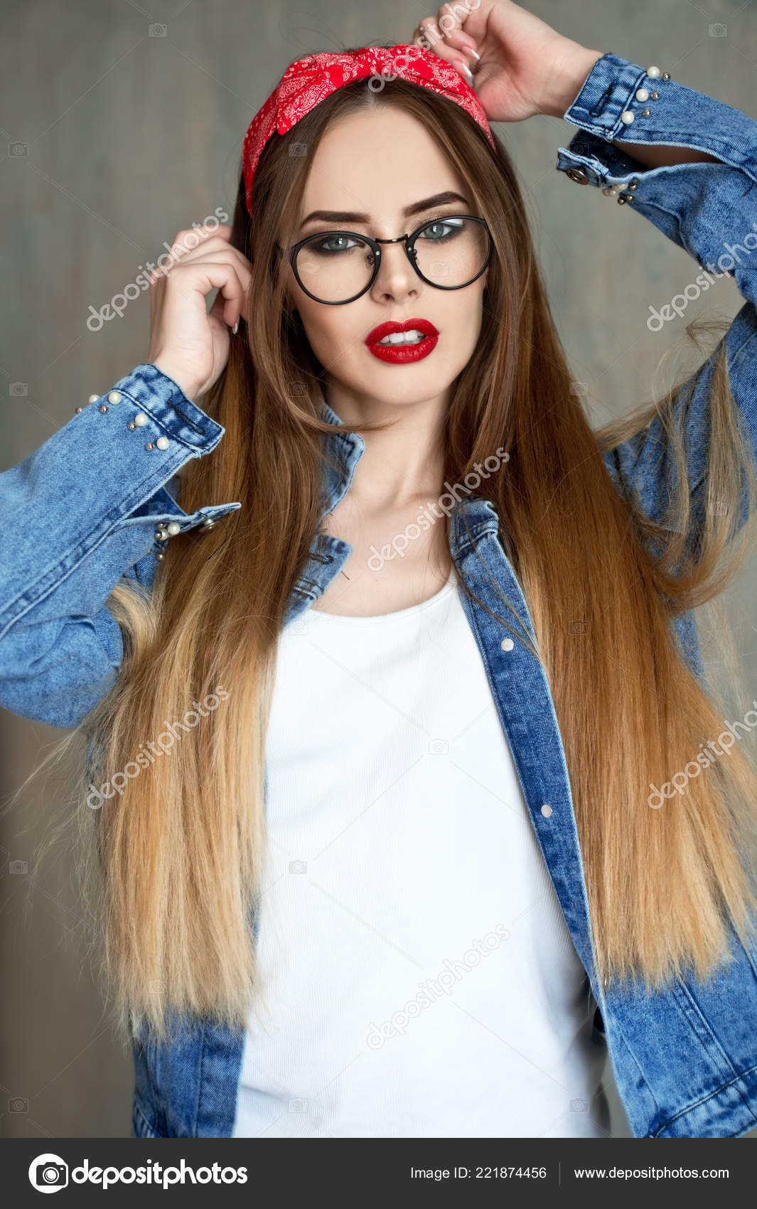 e233fcc050 Beautiful woman in glasses and red bandana and jeans shirt. Beautiful girl  with pretty smile.