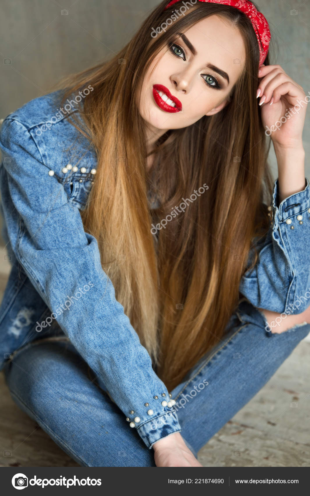 abdde4ec124 Beautiful woman in glasses and red bandana and jeans shirt. Beautiful girl  with pretty smile.