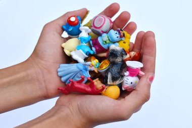 ��ollection of different figures of toys from Kinder Surprises.