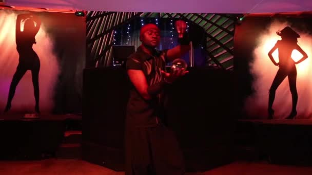 LOS ANGELES, USA - FEBRUARY 2018:. African American dark skinned man show a performance with glass balls in a night club.