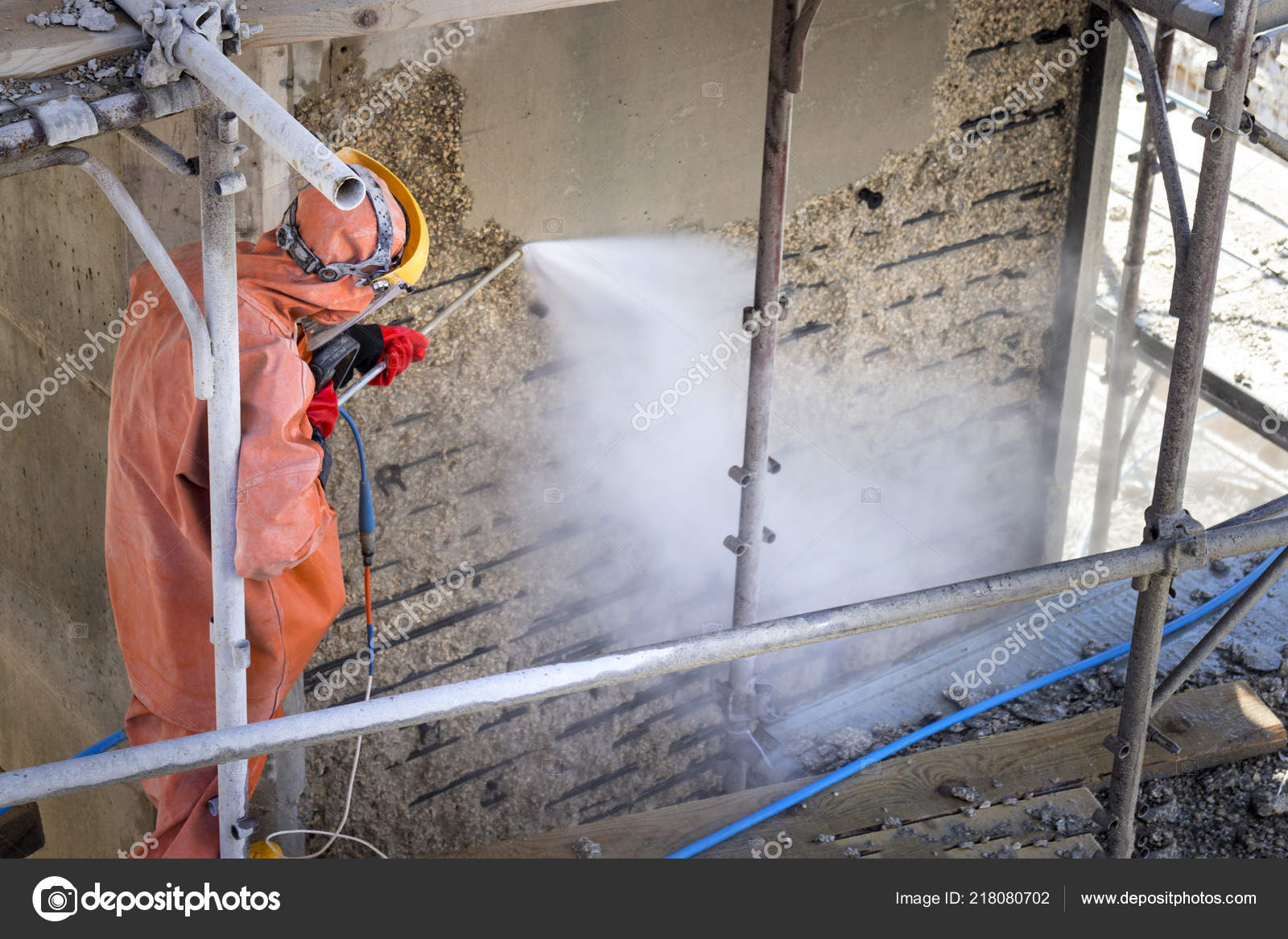 Worker Orange Protective Suit Cleans Corrosion Damaged Concrete