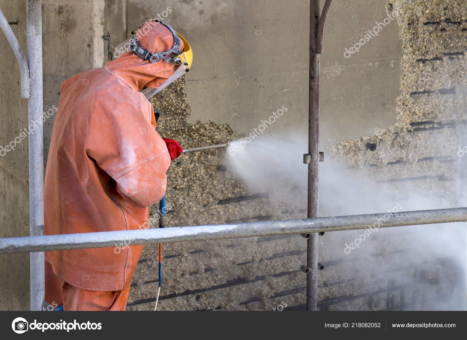 Worker Orange Protective Suit Cleans Corrosion Damaged Concrete