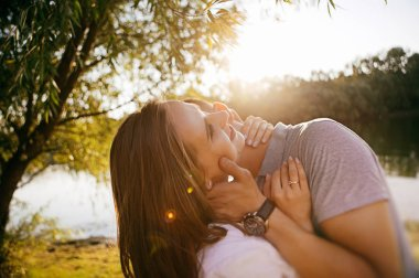 young couple in love posing on outdoor photo - session