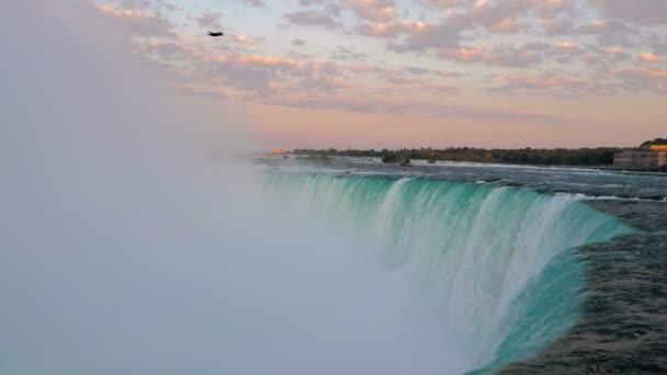 Niagara Falls with a bird flying over.