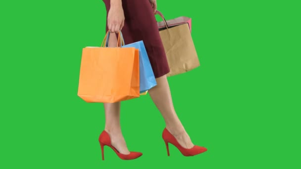 Legs of shopping lady with shopping bags on a Green Screen, Chroma Key.