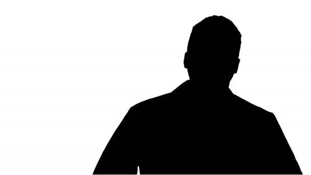 Silhouette férfi afrikai orvos áll a kezét a zsebében.