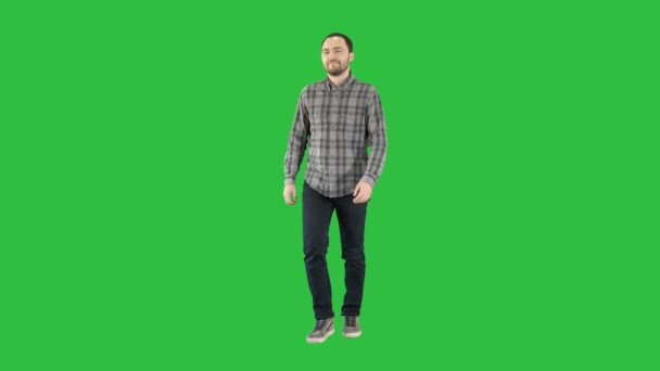 Young man walking in a good mood on a Green Screen, Chroma Key.
