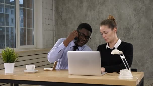 Businesswoman Using Laptop And Businessman Making Call Team work