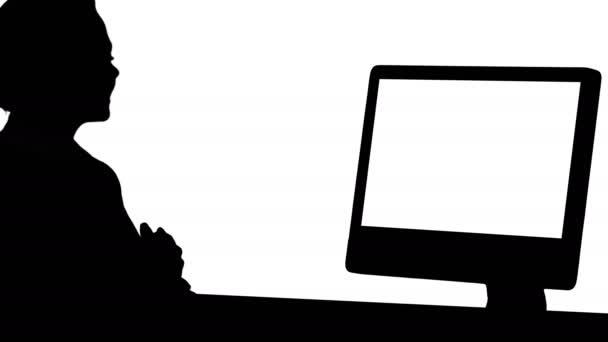 Silhouette-Video-Chat mit jemandem von jungen Frau.