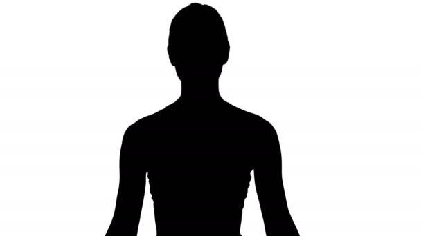 Silhouette Nő gyakorló jóga meditáció mosolygós.