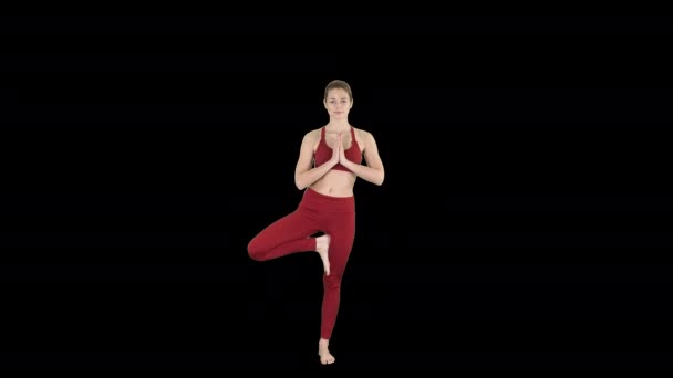 Young woman practicing yoga, standing in Utthita Hasta Padangustasana exercise, Extended Hand to Big Toe pose, Alpha Channel