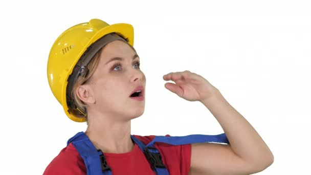 Close up. Engineer construction worker woman fascinated by the scale of construction on white background. Professional shot in 4K resolution. 006. You can use it e.g. in your commercial video