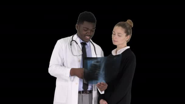 Doctor shows the patient chest x-ray, Alpha Channel