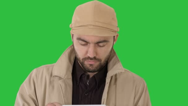 Face of handsome man using a digital tablet on a Green Screen, Chroma Key.
