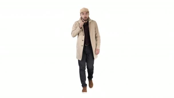 Handsome man in light trench coat talking to camera Focus and think about it gestures on white background.