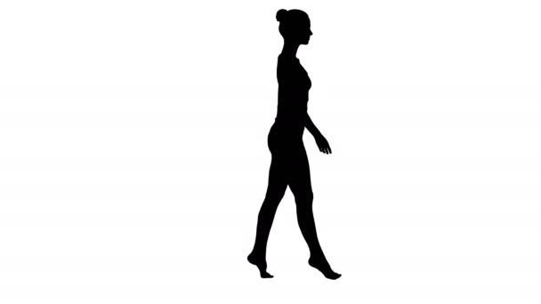 Silueta Mladá žena kráčí po špičkách.