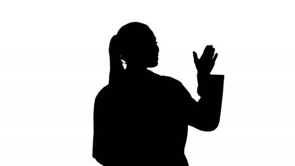 Silueta Doktorka ukazuje něco s nataženýma rukama. Prezentace.