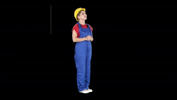 Engineer construction worker woman looking up at a building or statistics or graph laughing in the end, Alpha Channel