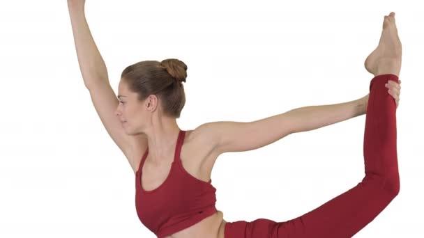 Mladý sportovní atraktivní žena cvičení jóga na bílém pozadí.