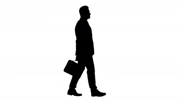 Silhouette Handsome businessman in a suit walks with a briefcase.