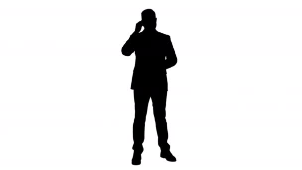 Silhouette Handsome businessman with headset looking into camera and smiling.